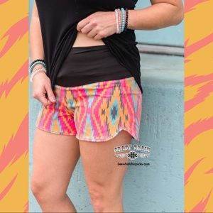 Bold Bomb.Com Board Shorts by Crazy Train